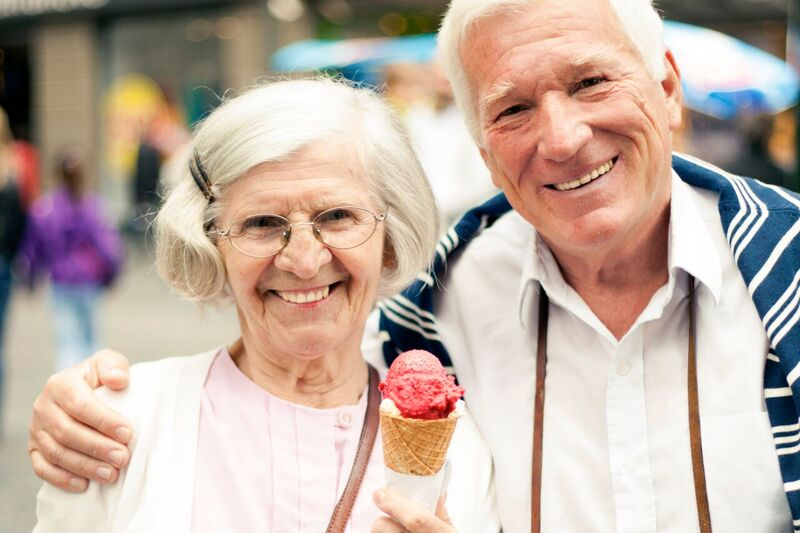 Senior couple, woman is holding an ice cream cone