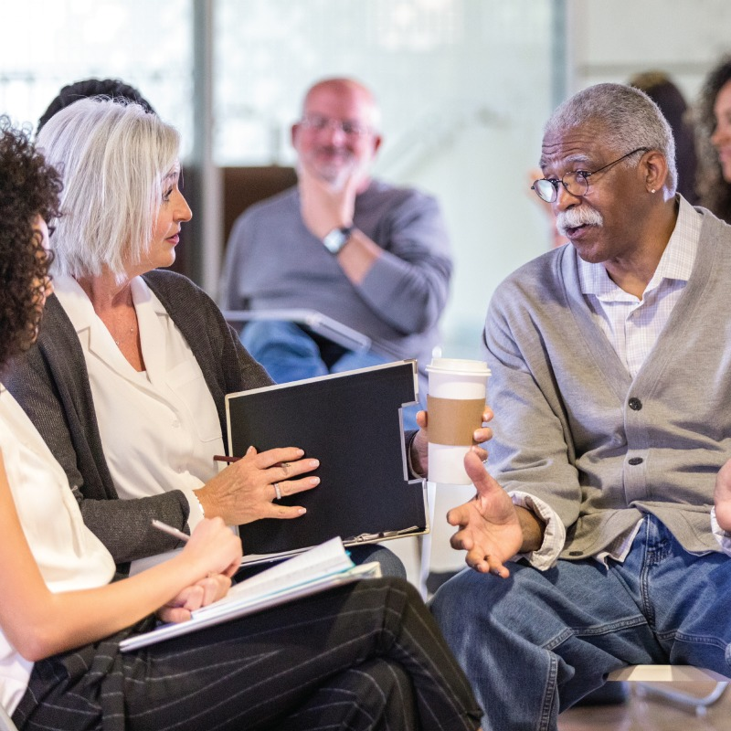 A family caregivers support group talking to each other
