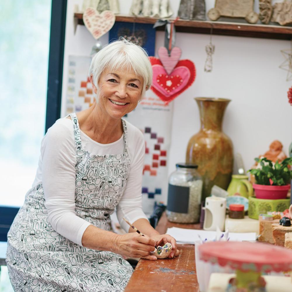 Senior woman at the crafting table