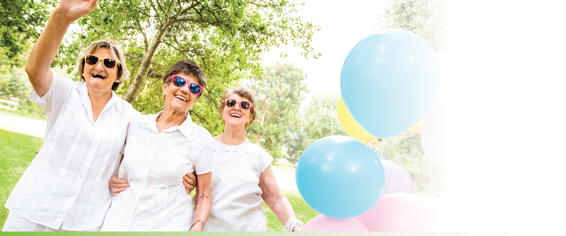 Group of senior women walking together with balloons